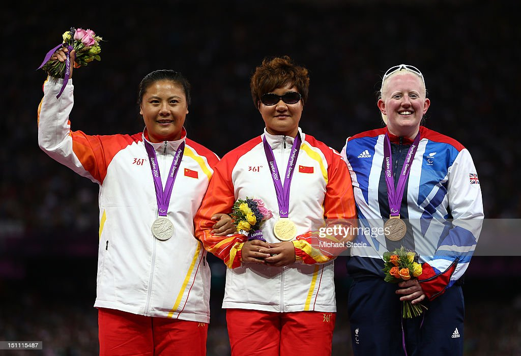 Silver medalist Hongxia Tang of China, gold medalist Liangmin Zhang of China and bronze medalist Claire Williams of Great Britain pose on the podium during the medal ceremony for the Women's Discus Throw - F11/12 on day 3 of the London 2012 Paralympic Games at Olympic Stadium on September 1, 2012 in London, England.