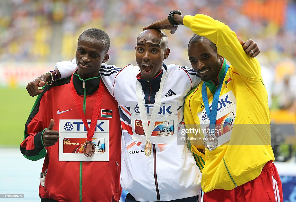 Silver medalist Ibrahim Jeilan of Ethiopia, gold medalist <a gi-track='captionPersonalityLinkClicked' href=/galleries/search?phrase=Mo+Farah&family=editorial&specificpeople=4819130 ng-click='$event.stopPropagation()'>Mo Farah</a> of Great Britain and bronze medalist <a gi-track='captionPersonalityLinkClicked' href=/galleries/search?phrase=Paul+Kipngetich+Tanui&family=editorial&specificpeople=6872538 ng-click='$event.stopPropagation()'>Paul Kipngetich Tanui</a> of Kenya stand on the podium during the medal ceremony for the Men's 10000 metres during Day One of the 14th IAAF World Athletics Championships Moscow 2013 at Luzhniki Stadium on August 10, 2013 in Moscow, Russia.