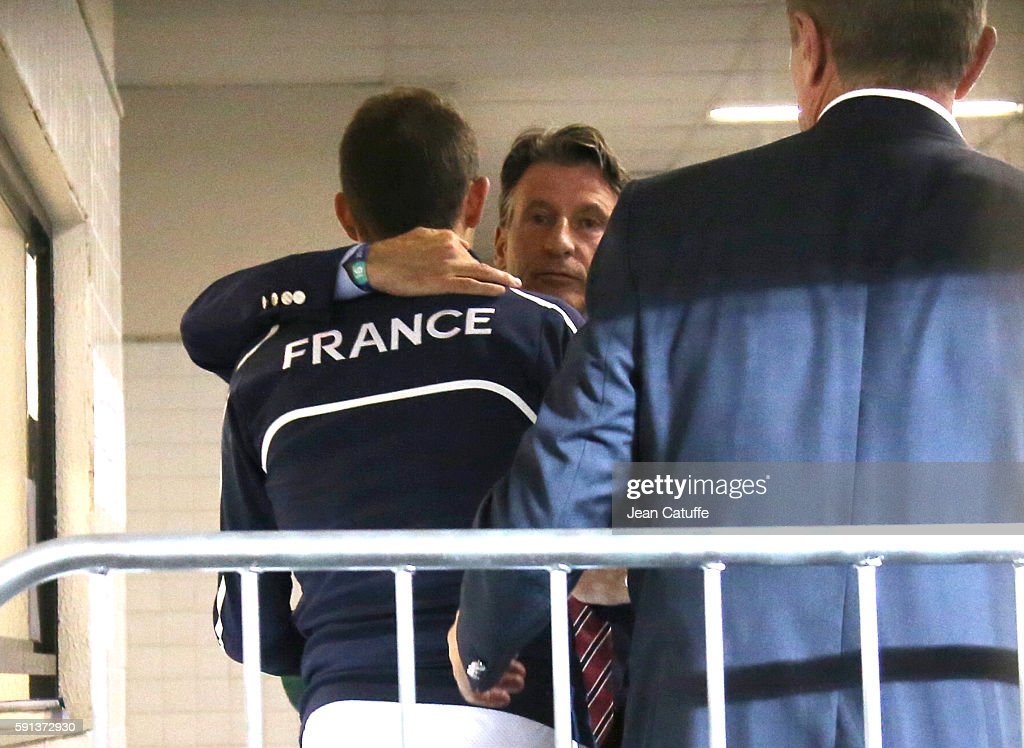 Silver medalist in Pole Vault Renaud Lavillenie of France is consoled by IAAF President Sebastian Coe and Sergey Bubka following the medal ceremony where he got booed by the public on day 11 of the Rio 2016 Olympic Games at Olympic Stadium on August 16, 2016 in Rio de Janeiro, Brazil.