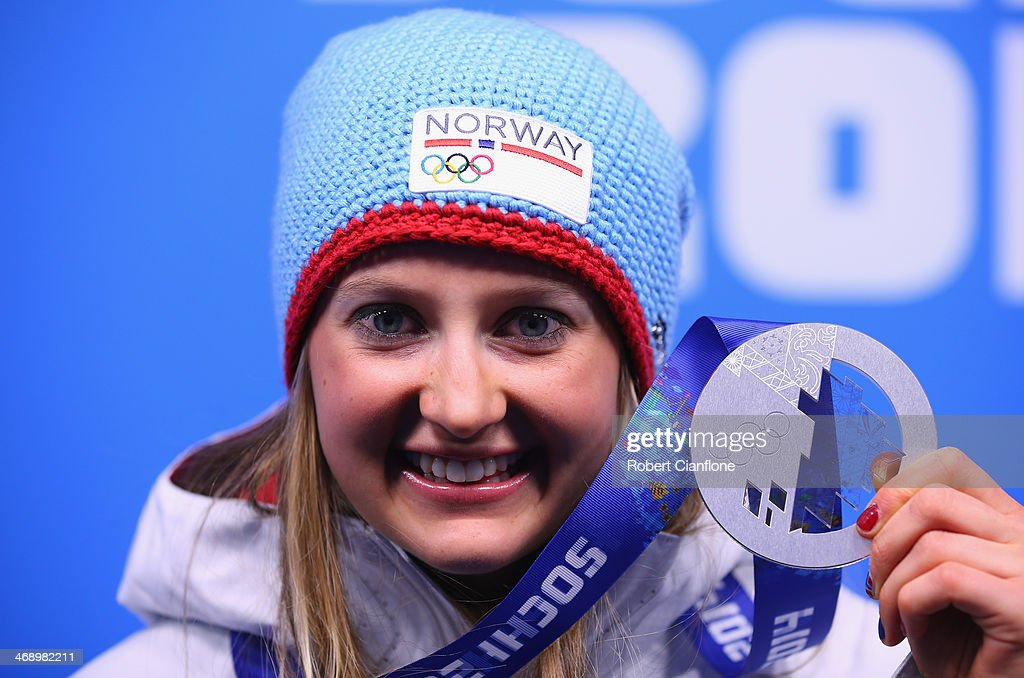 Silver medalist <a gi-track='captionPersonalityLinkClicked' href=/galleries/search?phrase=Ingvild+Flugstad+Oestberg&family=editorial&specificpeople=7427144 ng-click='$event.stopPropagation()'>Ingvild Flugstad Oestberg</a> of Norway celebrates during the medal for the Ladies' Sprint Free on day five of the Sochi 2014 Winter Olympics at Medals Plaza on February 12, 2014 in Sochi, Russia.