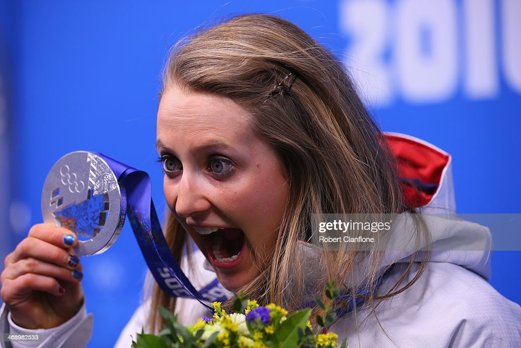 Silver medalist <a gi-track='captionPersonalityLinkClicked' href=/galleries/search?phrase=Ingvild+Flugstad+Oestberg&family=editorial&specificpeople=7427144 ng-click='$event.stopPropagation()'>Ingvild Flugstad Oestberg</a> of Norway celebrates during the medal ceremony for the Ladies' Sprint Free on day five of the Sochi 2014 Winter Olympics at Medals Plaza on February 12, 2014 in Sochi, Russia.