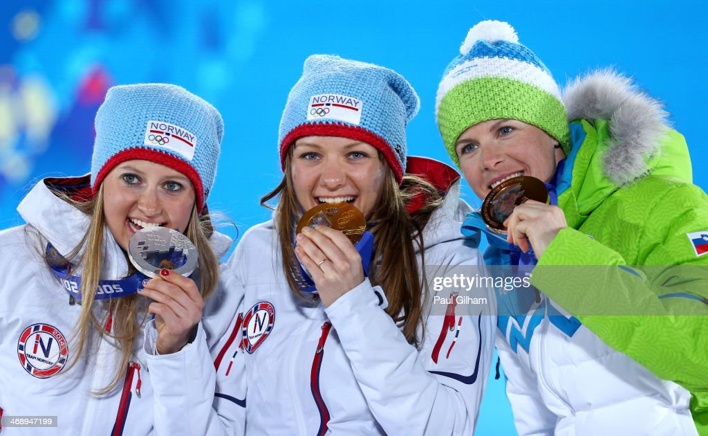 Silver medalist <a gi-track='captionPersonalityLinkClicked' href=/galleries/search?phrase=Ingvild+Flugstad+Oestberg&family=editorial&specificpeople=7427144 ng-click='$event.stopPropagation()'>Ingvild Flugstad Oestberg</a> of Norway, gold medalist <a gi-track='captionPersonalityLinkClicked' href=/galleries/search?phrase=Maiken+Caspersen+Falla&family=editorial&specificpeople=5646017 ng-click='$event.stopPropagation()'>Maiken Caspersen Falla</a> of Norway and bronze medalist <a gi-track='captionPersonalityLinkClicked' href=/galleries/search?phrase=Vesna+Fabjan&family=editorial&specificpeople=817752 ng-click='$event.stopPropagation()'>Vesna Fabjan</a> of Slovenia celebrate on the podium during the medal ceremony for Ladies' Sprint Free on day five of the Sochi 2014 Winter Olympics at Medals Plaza on February 12, 2014 in Sochi, Russia.
