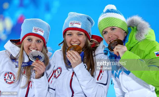 Silver medalist Ingvild Flugstad Oestberg of Norway gold medalist Maiken Caspersen Falla of Norway and bronze medalist Vesna Fabjan of Slovenia...