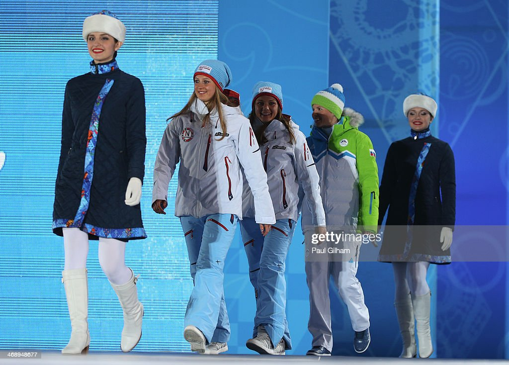 Silver medalist <a gi-track='captionPersonalityLinkClicked' href=/galleries/search?phrase=Ingvild+Flugstad+Oestberg&family=editorial&specificpeople=7427144 ng-click='$event.stopPropagation()'>Ingvild Flugstad Oestberg</a> of Norway, gold medalist <a gi-track='captionPersonalityLinkClicked' href=/galleries/search?phrase=Maiken+Caspersen+Falla&family=editorial&specificpeople=5646017 ng-click='$event.stopPropagation()'>Maiken Caspersen Falla</a> of Norway and bronze medalist <a gi-track='captionPersonalityLinkClicked' href=/galleries/search?phrase=Vesna+Fabjan&family=editorial&specificpeople=817752 ng-click='$event.stopPropagation()'>Vesna Fabjan</a> of Slovenia are led on stage during the medal ceremony for Ladies' Sprint Free on day five of the Sochi 2014 Winter Olympics at Medals Plaza on February 12, 2014 in Sochi, Russia.