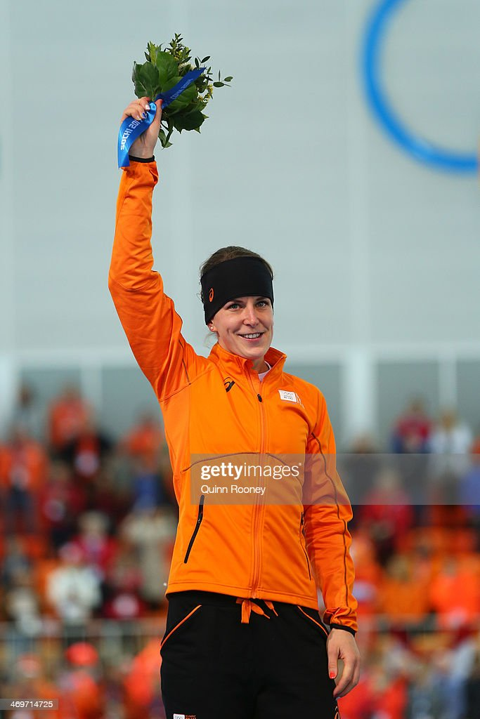 Silver medalist Ireen Wust of the Netherlands celebrates during the flower ceremony for the Speed Skating Women's 1500m on day 9 of the Sochi 2014 Winter Olympics at Adler Arena Skating Center on February 16, 2014 in Sochi, Russia.