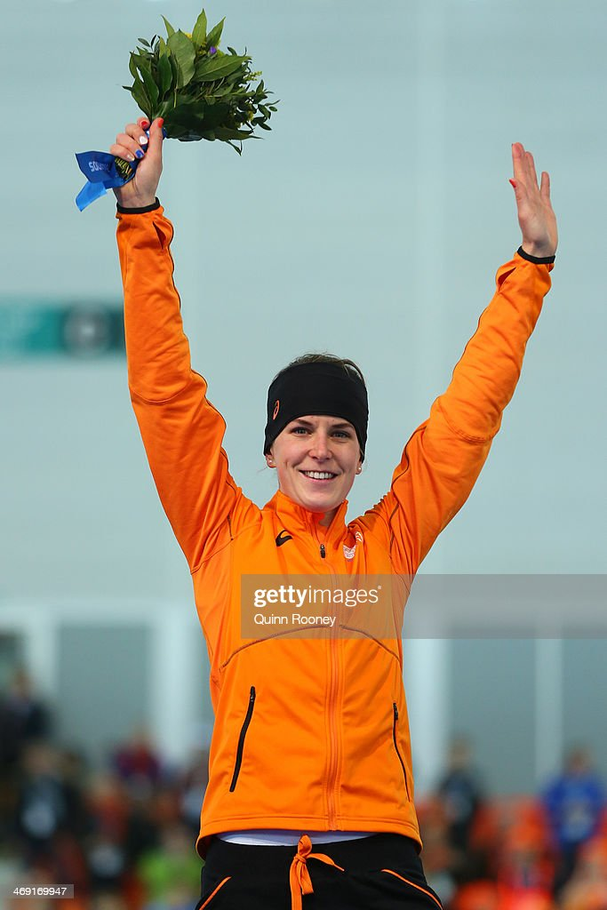 Silver medalist Ireen Wust of the Netherlands celebrates on the podium during the flower ceremony for the Speed Skating Women's 1000m event on day 6 of the Sochi 2014 Winter Olympics at Adler Arena Skating Center on February 13, 2014 in Sochi, Russia.