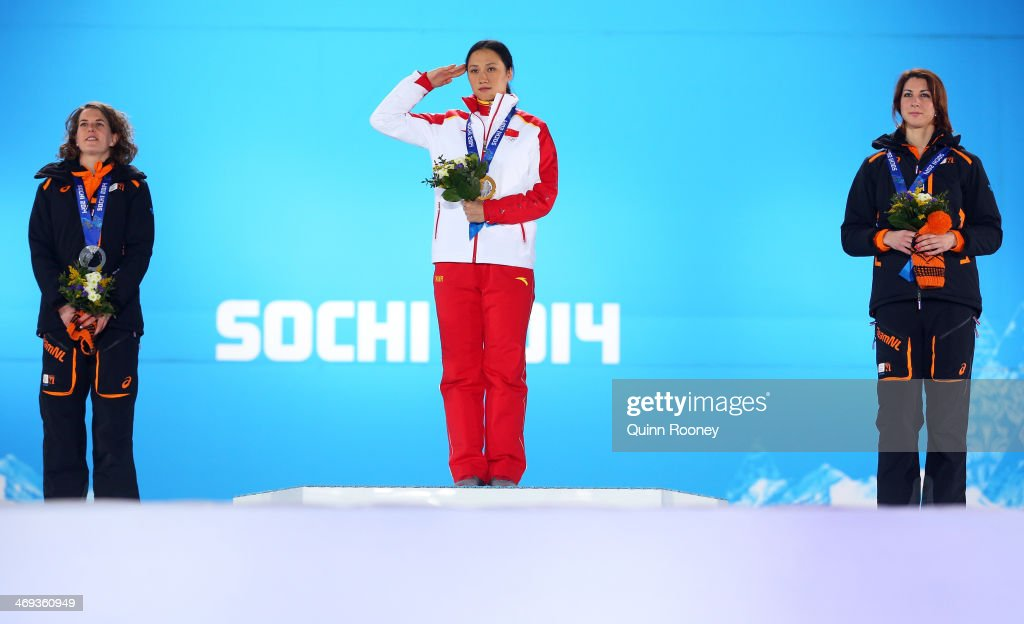 Silver medalist Ireen Wust of the Netherlands, gold medalist Hong Zhang of China and bronze medalist <a gi-track='captionPersonalityLinkClicked' href=/galleries/search?phrase=Margot+Boer&family=editorial&specificpeople=4691692 ng-click='$event.stopPropagation()'>Margot Boer</a> of the Netherlands celebrate on the podium during the medal ceremony for the Speed Skating Women's 1000m on day 7 of the Sochi 2014 Winter Olympics at Medals Plaza on February 14, 2014 in Sochi, Russia.