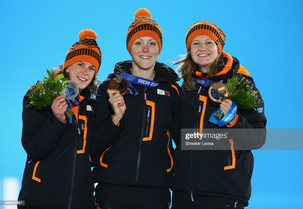 Silver medalist Ireen Wust of the Netherlands, gold medalist Jorien ter Mors of the Netherlands and bronze medalist <a gi-track='captionPersonalityLinkClicked' href=/galleries/search?phrase=Lotte+van+Beek&family=editorial&specificpeople=9989212 ng-click='$event.stopPropagation()'>Lotte van Beek</a> of the Netherlands celebrate on the podium during the flower ceremony on day ten of the Sochi 2014 Winter Olympics at the Medals Plaza on February 17, 2014 in Sochi, Russia.
