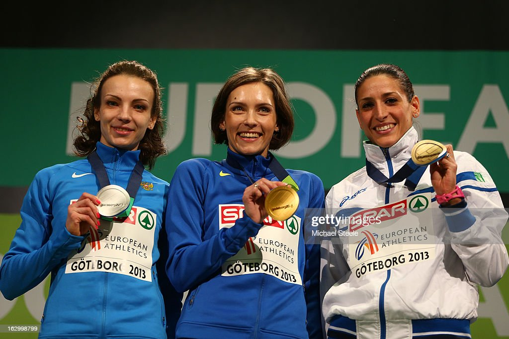 Silver medalist Irina Gumeniuk of Russia, Gold medalist Olha Saladuha of Ukraine and Bronze medalist Simona La Mantia of Italy pose during the victory ceremony for the Women's Triple Jump during day three of European Indoor Athletics at Scandinavium on March 3, 2013 in Gothenburg, Sweden.
