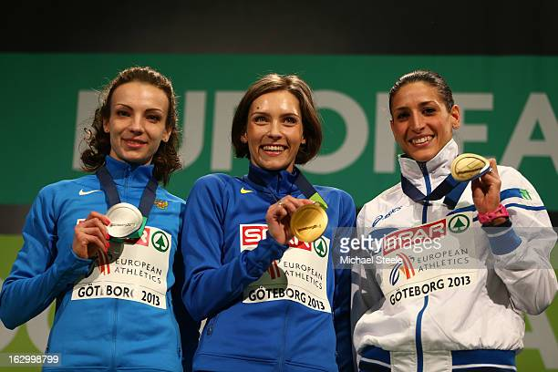 Silver medalist Irina Gumeniuk of Russia Gold medalist Olha Saladuha of Ukraine and Bronze medalist Simona La Mantia of Italy pose during the victory...