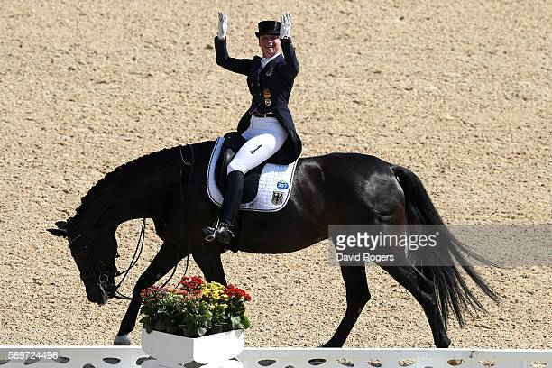 Silver medalist Isabell Werth of Germany riding Weihegold Old celebrates during Dressage Individual Grand Prix Freestyle on Day 10 of the Rio 2016...