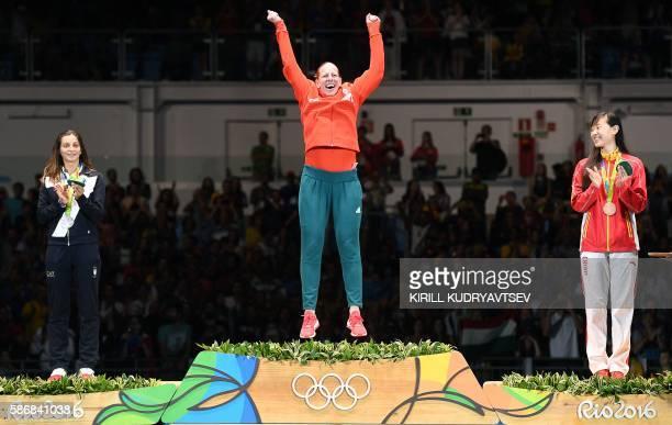 TOPSHOT Silver medalist Italy's Rossella Fiamingo gold medalist Hungary's Emese Szasz and bronze medalist China's Sun Yiwen celebrate on the podium...