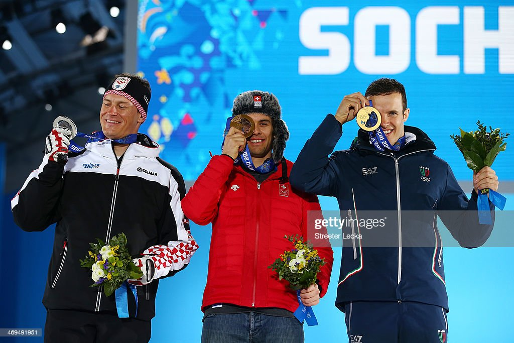 Silver medalist <a gi-track='captionPersonalityLinkClicked' href=/galleries/search?phrase=Ivica+Kostelic&family=editorial&specificpeople=241265 ng-click='$event.stopPropagation()'>Ivica Kostelic</a> of Crioatia, gold medalist <a gi-track='captionPersonalityLinkClicked' href=/galleries/search?phrase=Sandro+Viletta&family=editorial&specificpeople=5638588 ng-click='$event.stopPropagation()'>Sandro Viletta</a> of Switzerland and bronze medalist <a gi-track='captionPersonalityLinkClicked' href=/galleries/search?phrase=Christof+Innerhofer&family=editorial&specificpeople=4104734 ng-click='$event.stopPropagation()'>Christof Innerhofer</a> of Italy celebrate on the podium during the medal ceremony for the Alpine Skiing Men's Super Combined on day 8 of the Sochi 2014 Winter Olympics at Medals Plaza on February 15, 2014 in Sochi, Russia.