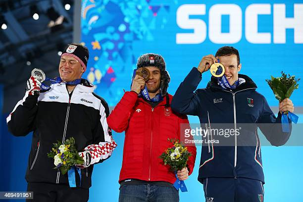 Silver medalist Ivica Kostelic of Crioatia gold medalist Sandro Viletta of Switzerland and bronze medalist Christof Innerhofer of Italy celebrate on...