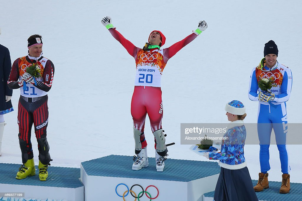 Silver medalist <a gi-track='captionPersonalityLinkClicked' href=/galleries/search?phrase=Ivica+Kostelic&family=editorial&specificpeople=241265 ng-click='$event.stopPropagation()'>Ivica Kostelic</a> of Croatia, gold medalist <a gi-track='captionPersonalityLinkClicked' href=/galleries/search?phrase=Sandro+Viletta&family=editorial&specificpeople=5638588 ng-click='$event.stopPropagation()'>Sandro Viletta</a> of Switzerland and bronze medalist <a gi-track='captionPersonalityLinkClicked' href=/galleries/search?phrase=Christof+Innerhofer&family=editorial&specificpeople=4104734 ng-click='$event.stopPropagation()'>Christof Innerhofer</a> of Italy celebrate during the flower ceremony for the Alpine Skiing Men's Super Combined Downhill on day 7 of the Sochi 2014 Winter Olympics at Rosa Khutor Alpine Center on February 14, 2014 in Sochi, Russia.