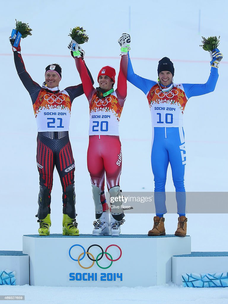 Silver medalist Ivica Kostelic of Croatia, gold medalist Sandro Viletta of Switzerland and bronze medalist Christof Innerhofer of Italy celebrate during the flower ceremony for the Alpine Skiing Men's Super Combined Downhill on day 7 of the Sochi 2014 Winter Olympics at Rosa Khutor Alpine Center on February 14, 2014 in Sochi, Russia.