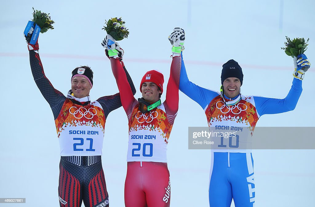 Silver medalist Ivica Kostelic of Croatia gold medalist Sandro Viletta of Switzerland and bronze medalist Christof Innerhofer of Italy celebrate...