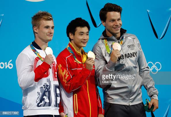 Silver medalist Jack Laugher of Great Britain gold medalist Yuan Cao of China and bronze medalist Patrick Hausding of Germany pose during the medal...