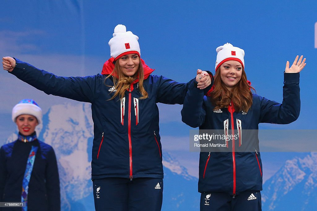 Silver medalist Jade Etherington (R) of Great Britain with guide Caroline Powellon (L) celebrate at the medal ceremony for women's Super Combined Visually Impaired on day eight of the Sochi 2014 Paralympic Winter Games at Laura Cross-country Ski & Biathlon Center on March 15, 2014 in Sochi, Russia.