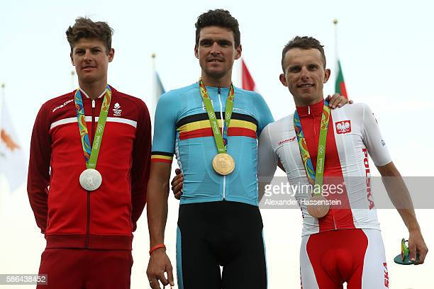 Silver medalist Jakob Fuglsang of Denmark Gold medalist Greg van Avermaet of Belgium and bronze medalist Rafal Majka of Poland celebrate on the...