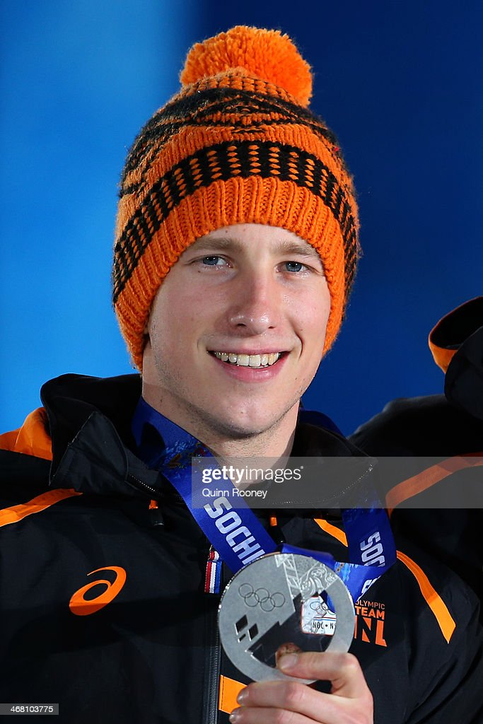 Silver medalist <a gi-track='captionPersonalityLinkClicked' href=/galleries/search?phrase=Jan+Blokhuijsen&family=editorial&specificpeople=4900694 ng-click='$event.stopPropagation()'>Jan Blokhuijsen</a> of the Netherlands celebrates during the medal ceremony for the Men's 5000m Speed Skating on day 2 of the Sochi 2014 Winter Olympics at Medals Plaza on February 9, 2014 in Sochi, .