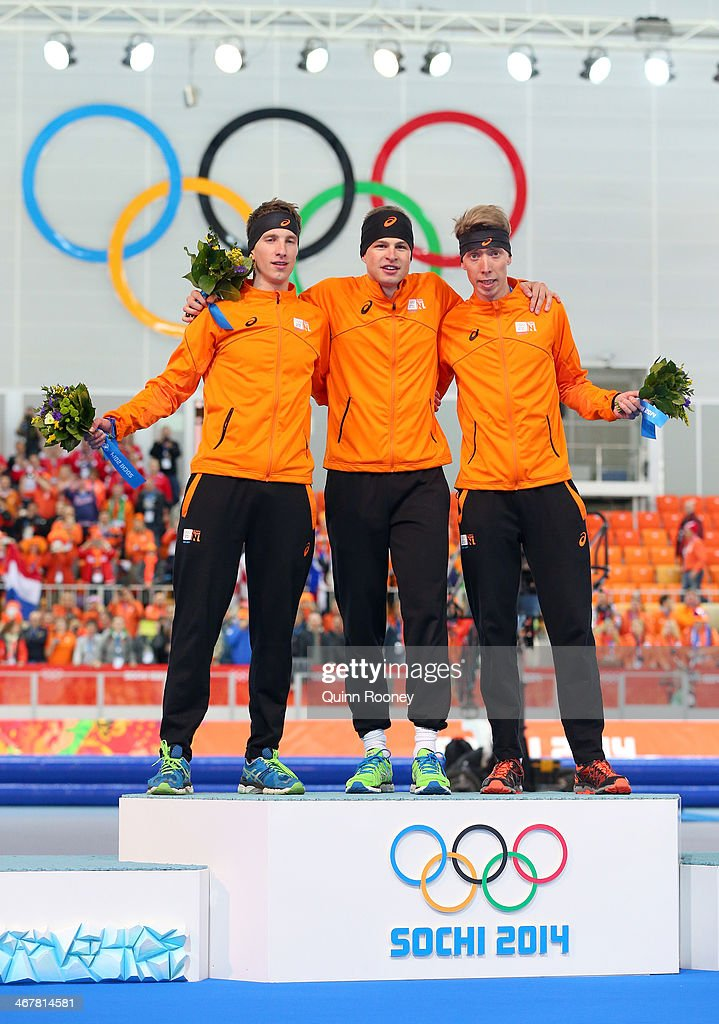 Silver medalist <a gi-track='captionPersonalityLinkClicked' href=/galleries/search?phrase=Jan+Blokhuijsen&family=editorial&specificpeople=4900694 ng-click='$event.stopPropagation()'>Jan Blokhuijsen</a> of the Netherlands, gold medalist <a gi-track='captionPersonalityLinkClicked' href=/galleries/search?phrase=Sven+Kramer&family=editorial&specificpeople=769363 ng-click='$event.stopPropagation()'>Sven Kramer</a> of the Netherlands and bronze medalist <a gi-track='captionPersonalityLinkClicked' href=/galleries/search?phrase=Jorrit+Bergsma&family=editorial&specificpeople=7364017 ng-click='$event.stopPropagation()'>Jorrit Bergsma</a> of the Netherlands on the podium during the flower ceremony for the Men's 5000m Speed Skating during day 1 of the Sochi 2014 Winter Olympics at Adler Arena Skating Center on February 8, 2014 in Sochi, Russia.