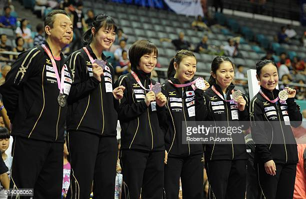 Silver medalist Japan team celebrate on the podium during the 2016 World Table Tennis Championship Women's Team Division awarding ceremony at...