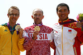 Silver medalist Jared Tallent of Australia gold medalist Sergey Kirdyapkin of Russia and bronze medalist Tianfeng Si of China pose during the medal...