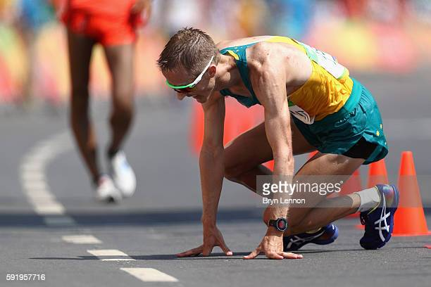 Silver medalist Jared Tallent of Australia reacts as he finishes the Men's 50km Race Walk on Day 14 of the Rio 2016 Olympic Games at Pontal on August...