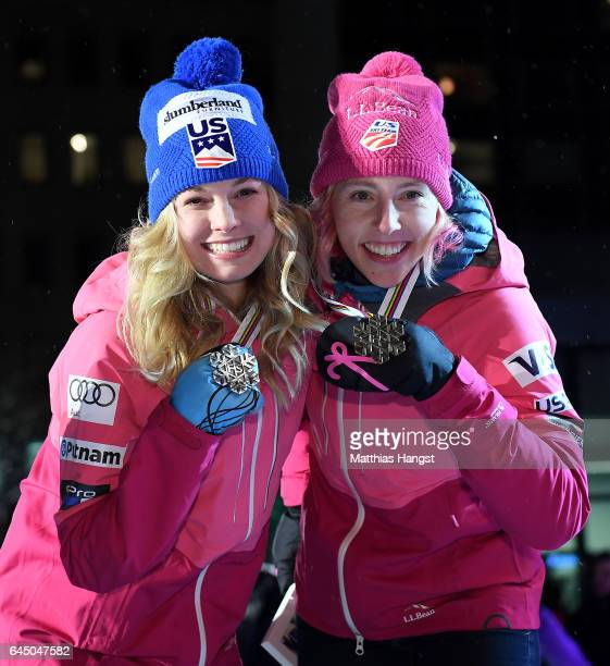 Silver medalist Jessica Diggins of the United States and bronze medalist Kikkan Randall of the United States pose with their medals during the medal...