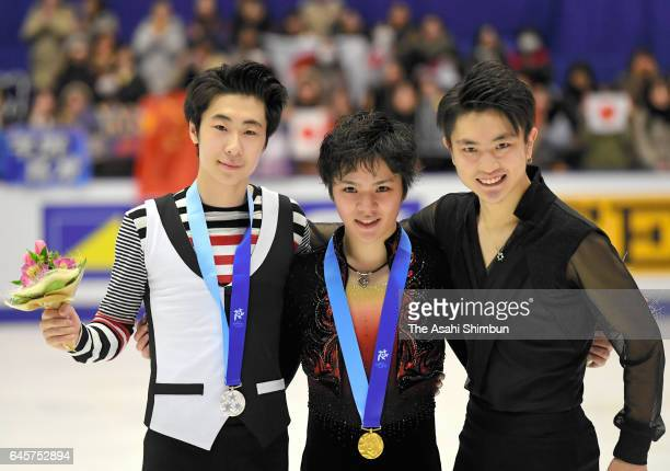 Silver medalist Jin Boyang of China gold medalist Shoma Uno of Japan and bronze medalist Yan Han of China pose on the podium at the medal ceremony...