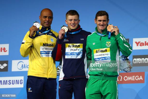 Silver medalist Joao Gomes Junior of Brazil gold medalist Adam Peaty of Great Britain and bronze medalist Cameron Van Der Burgh of South Africa pose...