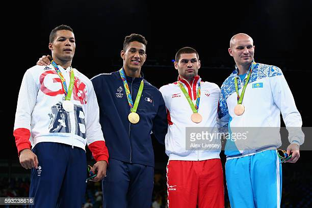 Silver medalist Joe Joyce of Great Britain gold medalist Tony Victor James Yoka of France and bronze medalists Filip Hrgovic of Croatia and Ivan...