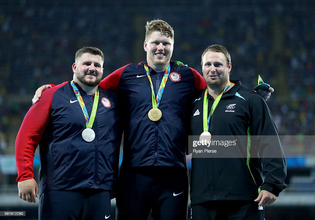 Silver medalist Joe Kovacs of the United States gold medalist Ryan Crouser of the United States and bronze medalist Tomas Walsh of New Zealand pose...