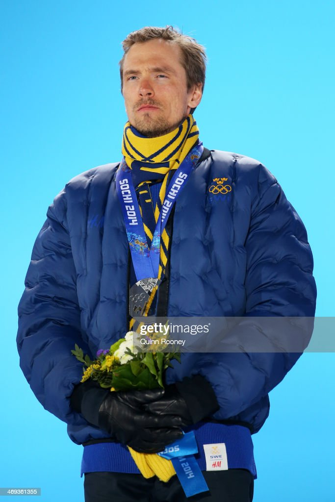 Silver medalist <a gi-track='captionPersonalityLinkClicked' href=/galleries/search?phrase=Johan+Olsson&family=editorial&specificpeople=724246 ng-click='$event.stopPropagation()'>Johan Olsson</a> of Sweden celebrates during the medal for the Cross Country Men's 15km Classic event on day 7 of the Sochi 2014 Winter Olympics at Medals Plaza on February 14, 2014 in Sochi, Russia.