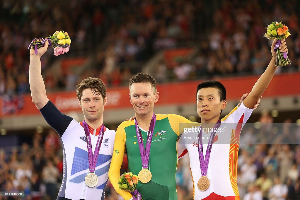 Silver medalist JonAllan Butterworth of Great Britain Gold medalist Michael Gallagher of Australia and bronze medalist Xinyang Liu of China pose on...