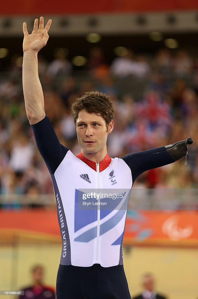 Silver medalist JonAllan Butterworth of Great Britain poses on the podium during the medal ceremony for the Men's Individual C45 1km Cycling Time...