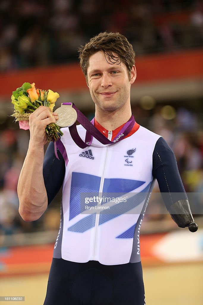 Silver medalist JonAllan Butterworth of Great Britain poses on the podium during the medal ceremony in the Men's Individual C5 Pursuit Final on day 3...
