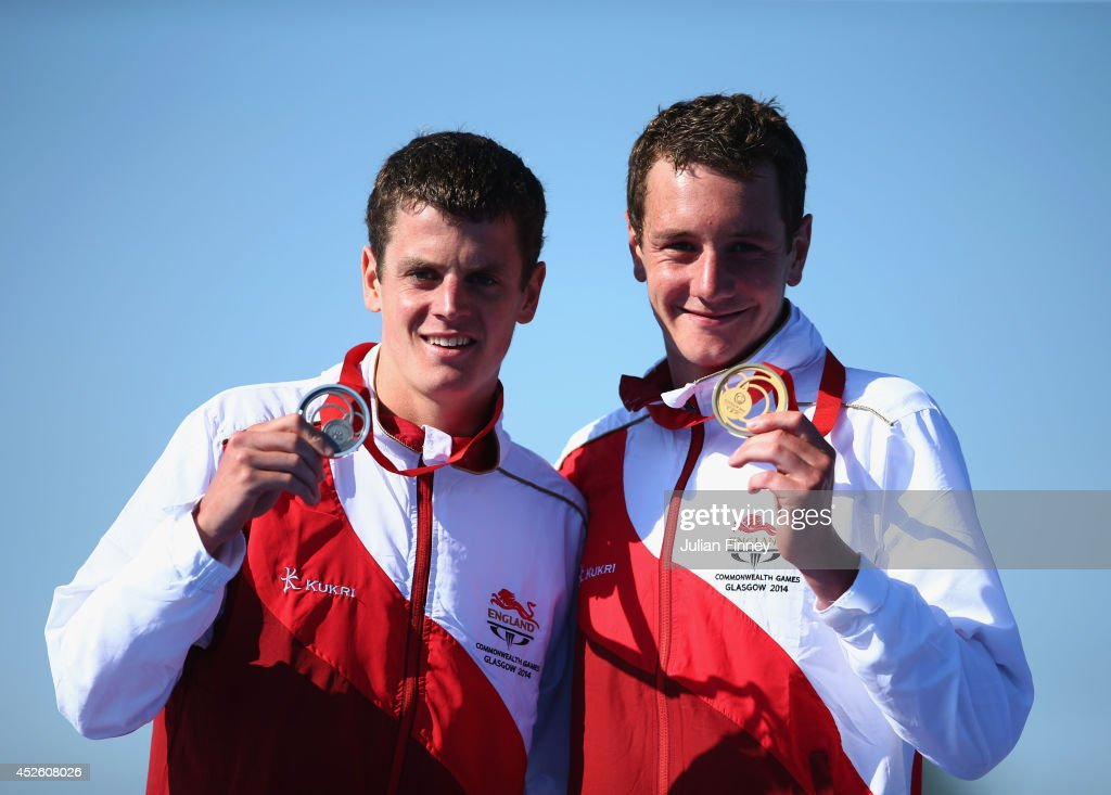 Silver medalist Jonathan Brownlee of England and Gold medalist Alistair Brownlee of England celebrate on the podium during the medal ceremony for the...