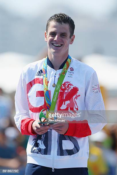 Silver medalist Jonathan Brownlee of Great Britain celebrates on the podium during the Men's Triathlon at Fort Copacabana on Day 13 of the 2016 Rio...