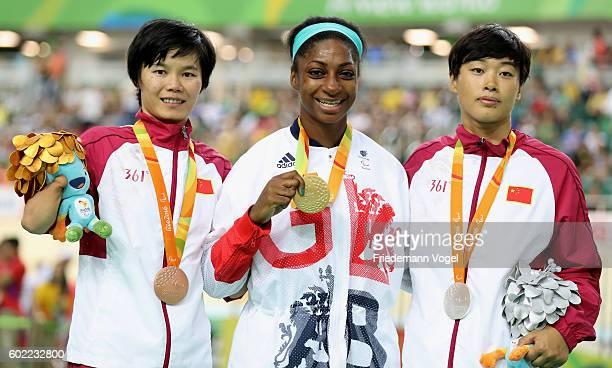 Silver medalist Jufang Zhou of China gold medalist Kadeena Cox of Great Britain and bronze medalist Jianping Ruan of China celebrate on the podium at...