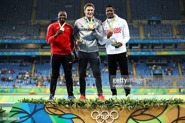Silver medalist Julius Yego of Kenya gold medalist Thomas Rohler of Germany and bronze medalist Keshorn Walcott of Trinidad and Tobago stand on the...