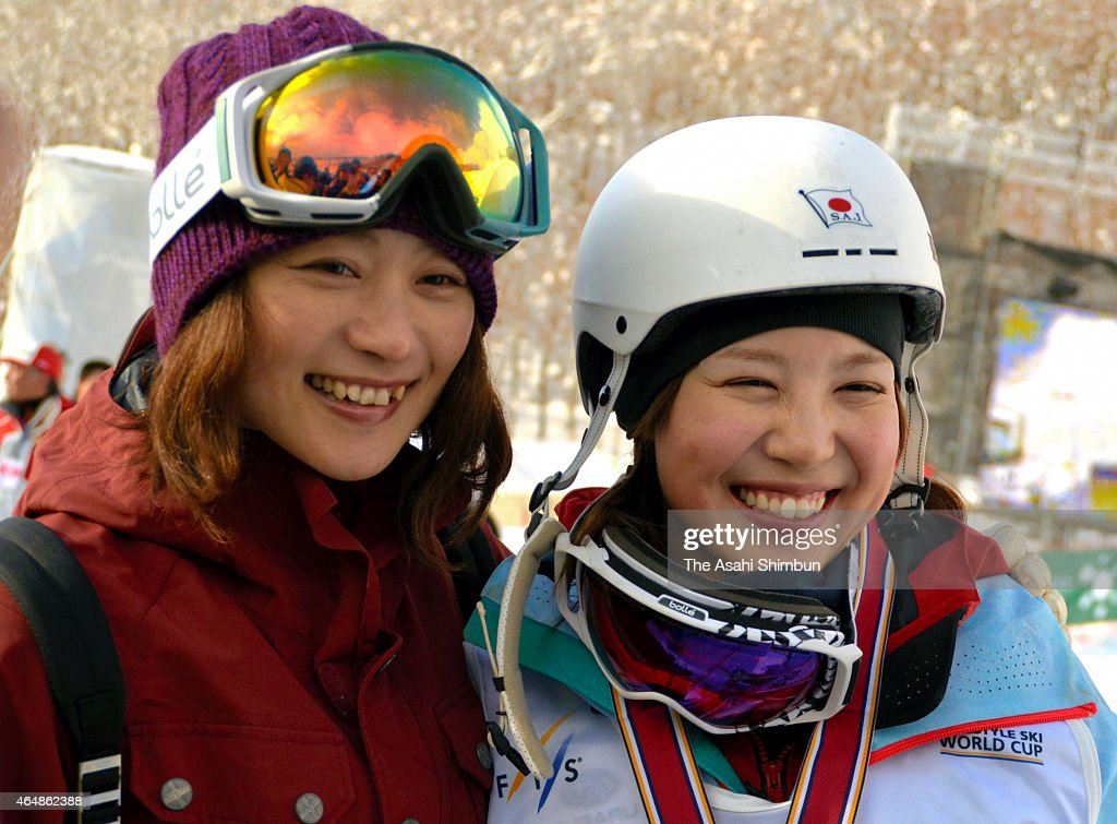 Silver medalist Junko Hoshino of Japan poses for photographs with former Mogul skier Aiko Uemura after the Ladies Mogul Final during day one of the...