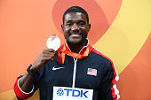 Silver medalist Justin Gatlin of the United States poses during the medal ceremony for the Men's 100 metres final during day three of the 15th IAAF...