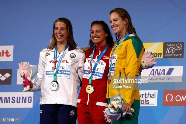Silver medalist Kathleen Baker of the United States gold medalist Kylie Jacqueline Masse of Canada and bronze medalist Emily Seebohm of Australia...