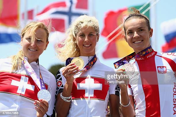 Silver medalist Kathrin Stirnemann of Switzerland Gold medalist Jolanda Neff of Switzerland and Bronze medalist Maja Wloszczowska of Poland celebrate...