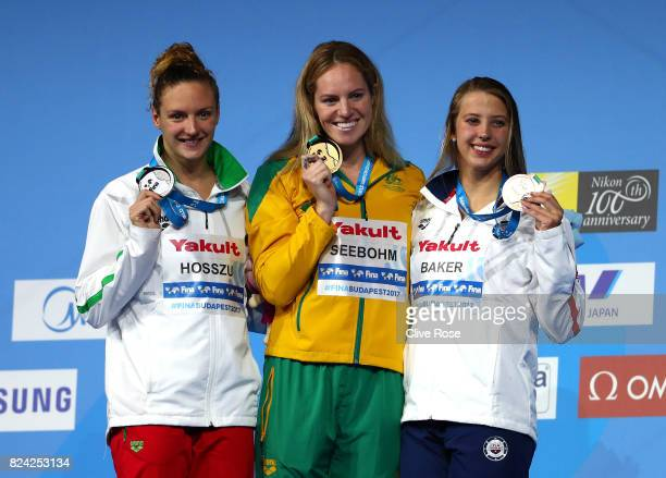 Silver medalist Katinka Hosszu of Hungary gold medalist Emily Seebohm of Australia and bronze medalist Kathleen Baker of the United States pose with...