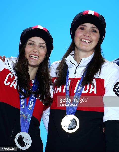 Silver medalist Kelsey Serwa of Canada and Gold medallist Marielle Thompson of Canada celebrate during the medal ceremony for the Women's Ski Cross...