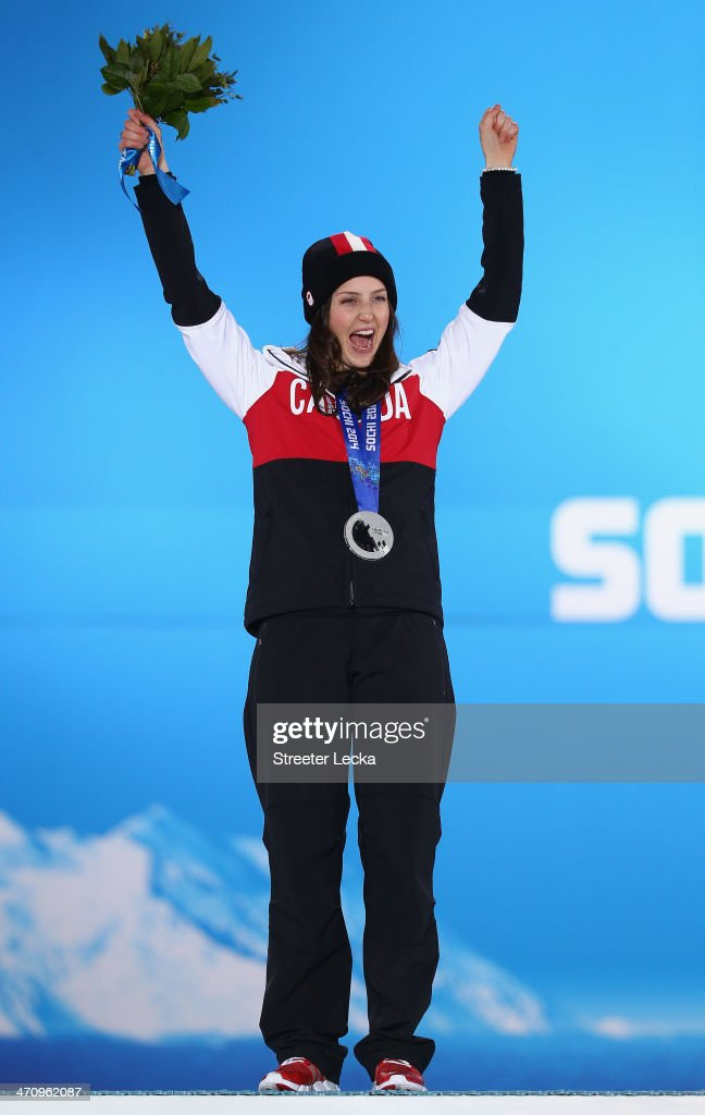 Silver medalist <a gi-track='captionPersonalityLinkClicked' href=/galleries/search?phrase=Kelsey+Serwa&family=editorial&specificpeople=5653399 ng-click='$event.stopPropagation()'>Kelsey Serwa</a> of Canada celebrates during the medal ceremony for the Women's Ski Cross on day fourteen of the Sochi 2014 Winter Olympics at Medals Plaza on February 21, 2014 in Sochi, Russia.