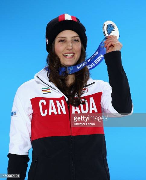 Silver medalist Kelsey Serwa of Canada celebrates during the medal ceremony for the Women's Ski Cross on day fourteen of the Sochi 2014 Winter...